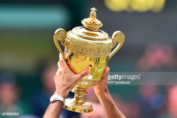 Switzerland's Roger Federer holds the winner's trophy after beating Croatia's Marin Cilic in their men's singles final match during the presentation...