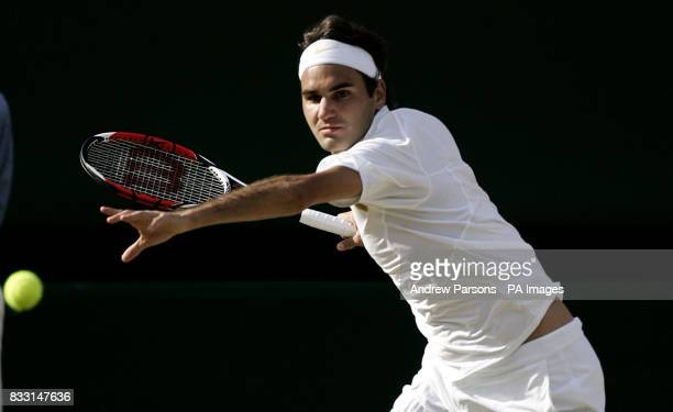Switzerland's Roger Federer in action against Spain's Rafael Nadal during The All England Lawn Tennis Championship at Wimbledon