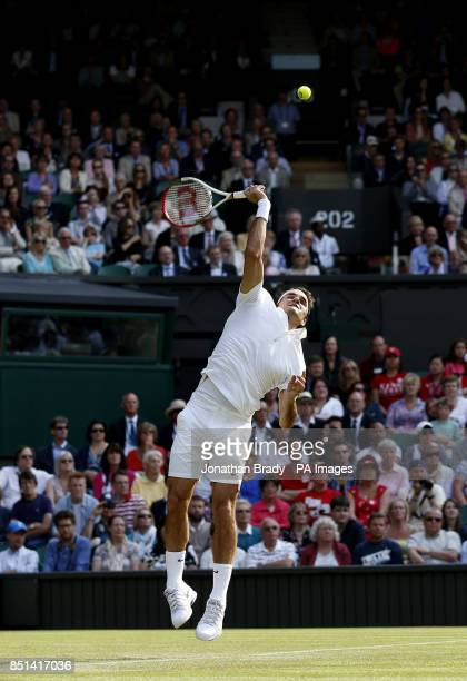 Switzerland's Roger Federer in his match against Ukraine's Sergiy Stakhovsky during day Three of the Wimbledon Championships at The All England Lawn...