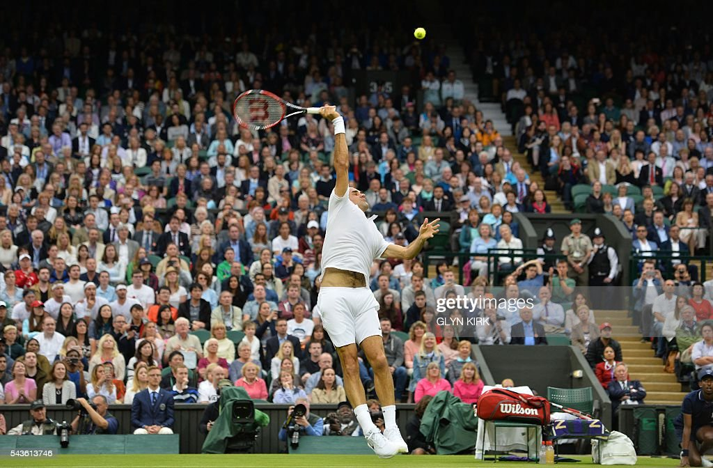 Switzerland's Roger Federer jumps for a return against Britain's Marcus Willis in their men's singles second round match on the third day of the 2016 Wimbledon Championships at The All England Lawn Tennis Club in Wimbledon, southwest London, on June 29, 2016. / AFP / GLYN