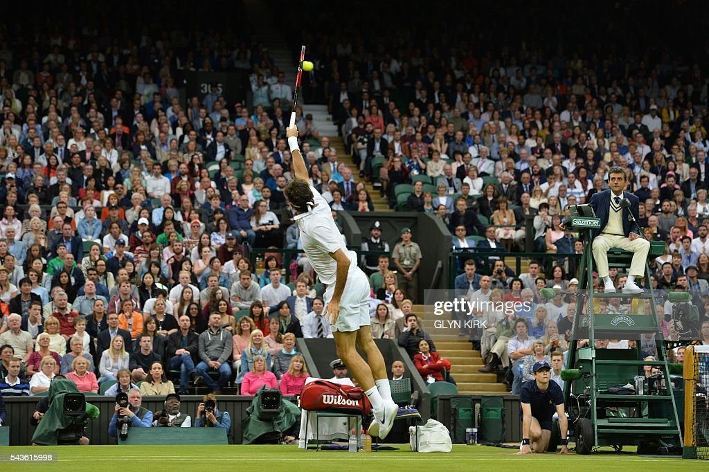 Switzerland's Roger Federer leaps to return a lob from Britain's Marcus Willis in their men's singles second round match on the third day of the 2016 Wimbledon Championships at The All England Lawn Tennis Club in Wimbledon, southwest London, on June 29, 2016. / AFP / GLYN