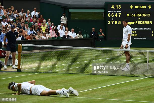 TOPSHOT Switzerland's Roger Federer lies on court after falling while trying to return to Canada's Milos Raonic during their men's semifinal match on...