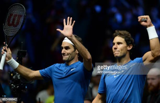 Switzerland's Roger Federer of Team Europe and his teammate Spain's Rafael Nadal celebrate their victory over team World's Sam Querrey and Jack Sock...