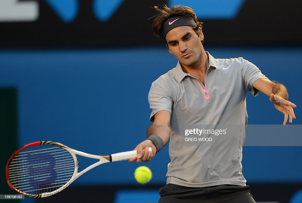 Switzerland's Roger Federer plays a return during his men's singles match against Australia's Bernard Tomic on the sixth day of the Australian Open tennis tournament in Melbourne on January 19, 2013.
