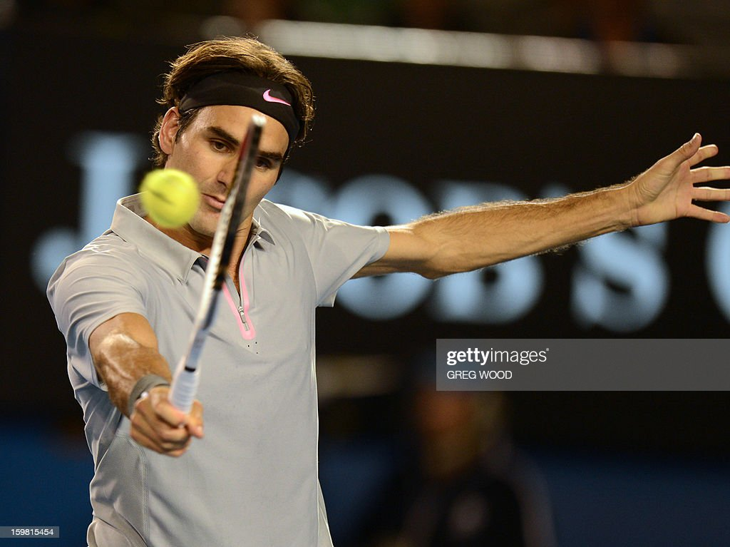 Switzerland's Roger Federer plays a return during his men's singles match against Canada's Milos Raonic on the eighth day of the Australian Open tennis tournament in Melbourne on January 21, 2013.