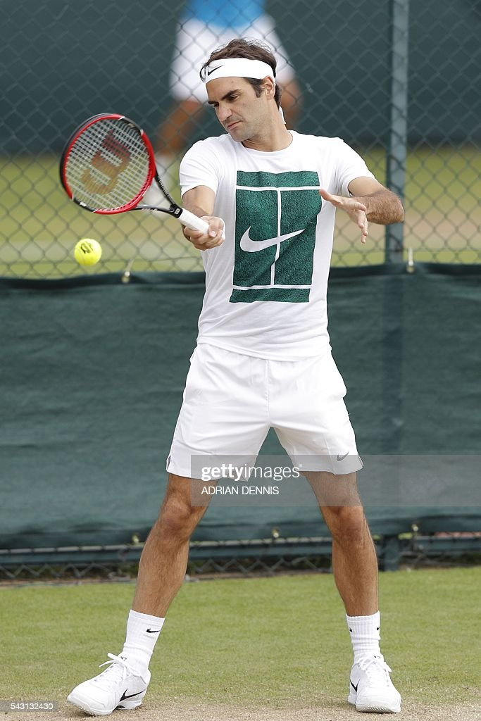 Switzerland's Roger Federer plays a shot on a practice court at The All England Tennis Club in Wimbledon, southwest London, on June 26, 2016, on the eve of the start of the 2016 Wimbledon Championships tennis tournament. / AFP / ADRIAN