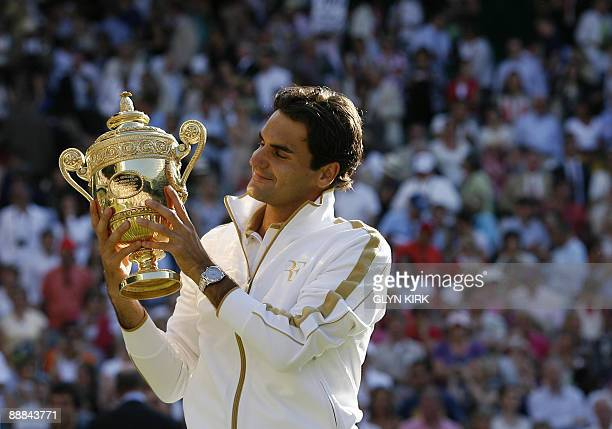 Switzerland's Roger Federer poses with the Wimbledon Trophy after beating Andy Roddick of the US in the Men's Singles Final of the 2009 Wimbledon...