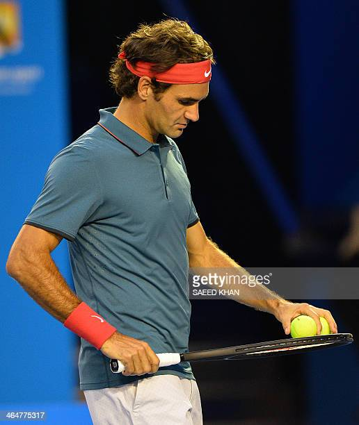 Switzerland's Roger Federer prepares to serve against Spain's Rafael Nadal during their men's singles semifinal match on day 12 of the 2014...