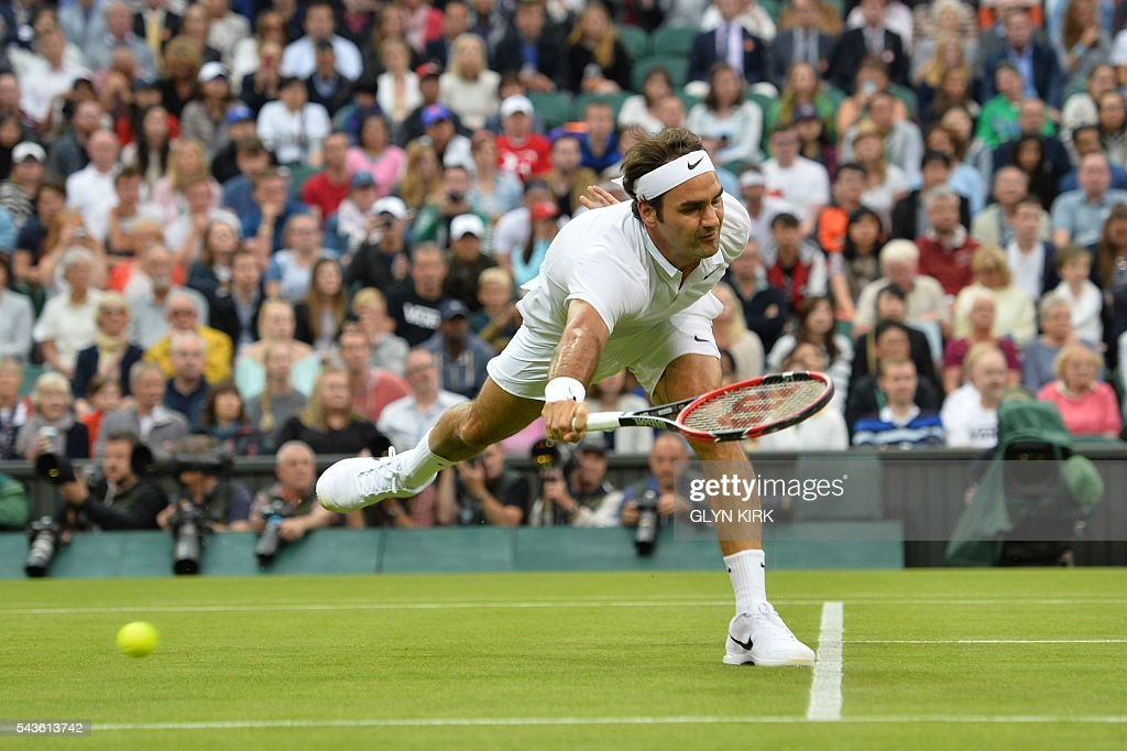 Switzerland's Roger Federer reaches but misses a return from Britain's Marcus Willis in their men's singles second round match on the third day of the 2016 Wimbledon Championships at The All England Lawn Tennis Club in Wimbledon, southwest London, on June 29, 2016. / AFP / GLYN