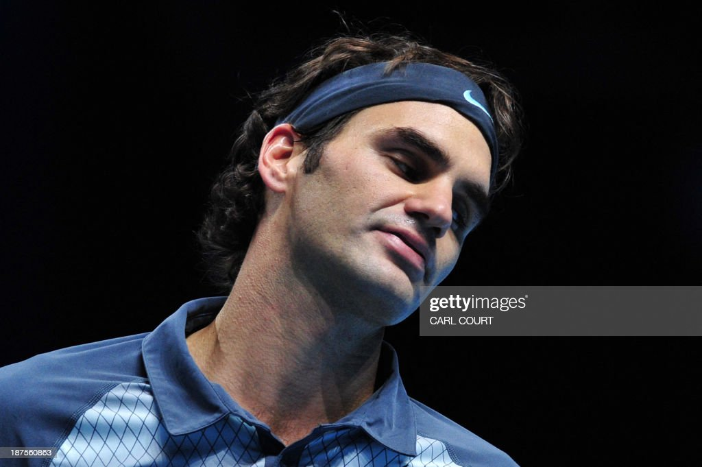 Switzerland's Roger Federer reacts after netting a return against Spain's Rafael Nadal during their singles semi-final match on the seventh day of the ATP World Tour Finals tennis tournament in London on November 10, 2013.