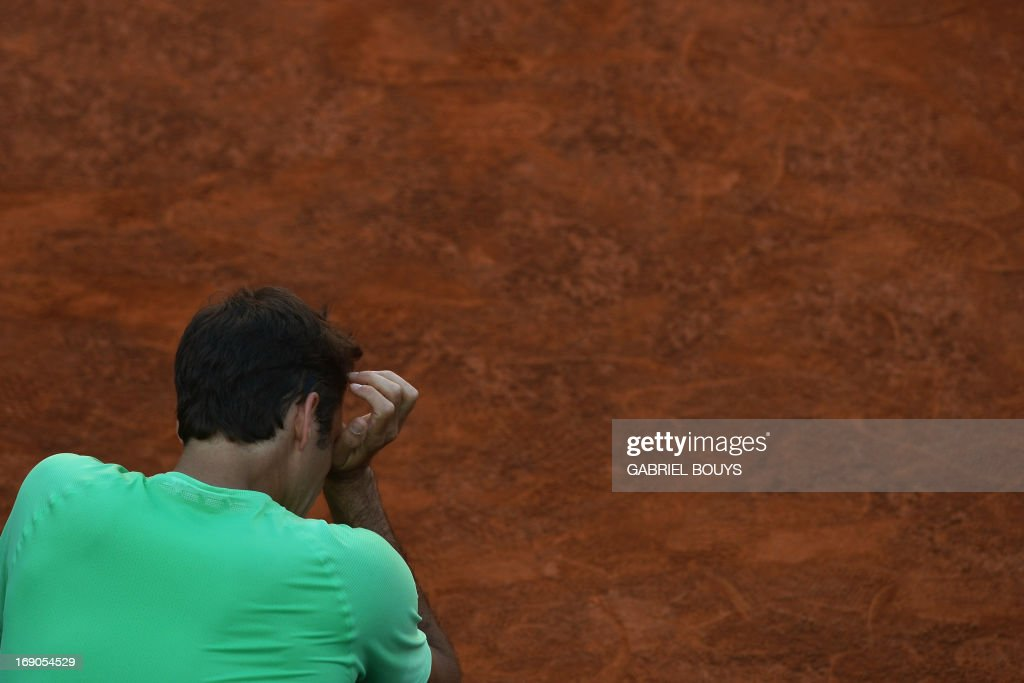 Switzerland's Roger Federer reacts after the final of the ATP Rome Masters against Spain's Rafael Nadal on May 19, 2013. Nadal defeated Federer to win the title.