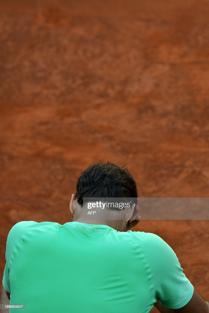 Switzerland's Roger Federer reacts after the final of the ATP Rome Masters against Spain's Rafael Nadal on May 19, 2013. Nadal defeated Federer to win the title. AFP PHOTO / GABRIEL BOUYS