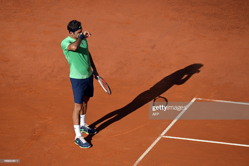 Switzerland's Roger Federer reacts at the end of the final of the ATP Rome Masters against Spain's Rafael Nadal on May 19, 2013. Nadal defeated Federer to win the title. AFP PHOTO / GABRIEL BOUYS
