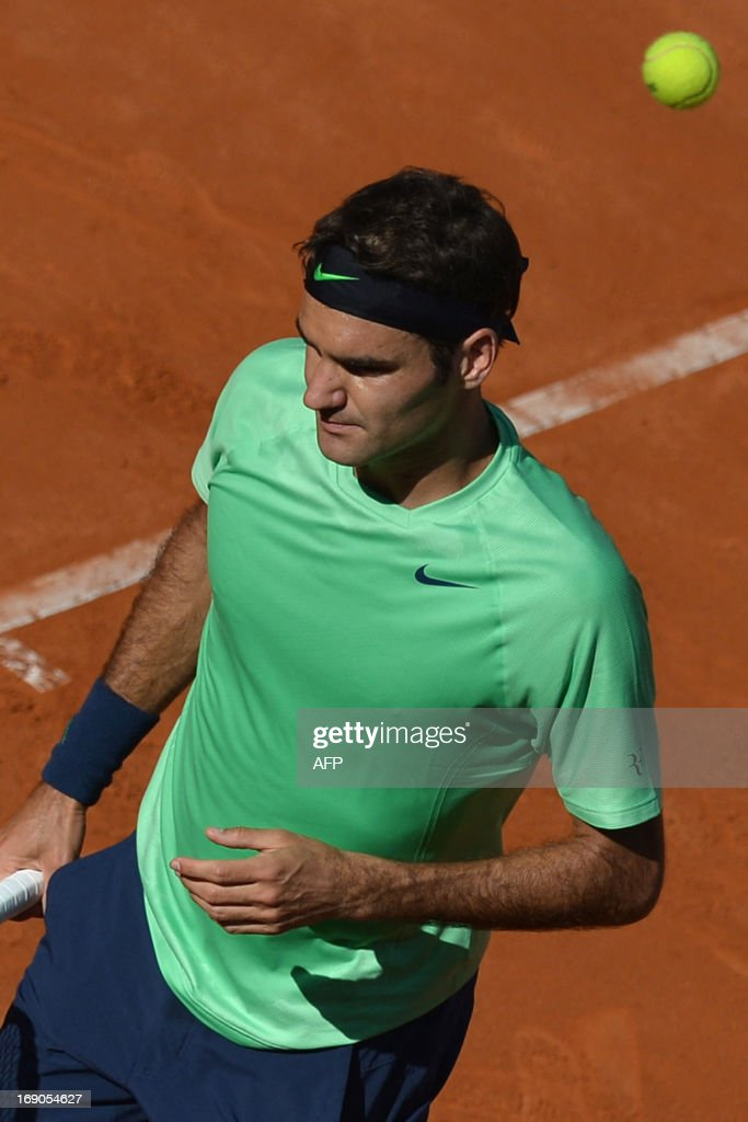 Switzerland's Roger Federer reacts at the end of the final of the ATP Rome Masters against Spain's Rafael Nadal on May 19, 2013. Nadal defeated Federer to win the title.