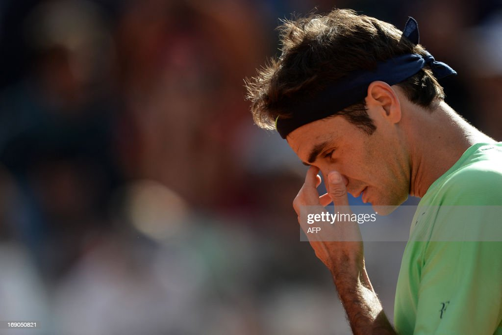 Switzerland's Roger Federer reacts during the final of the ATP Rome Masters against Spain's Rafael Nadal on May 19, 2013. AFP PHOTO / FILIPPO MONTEFORTE