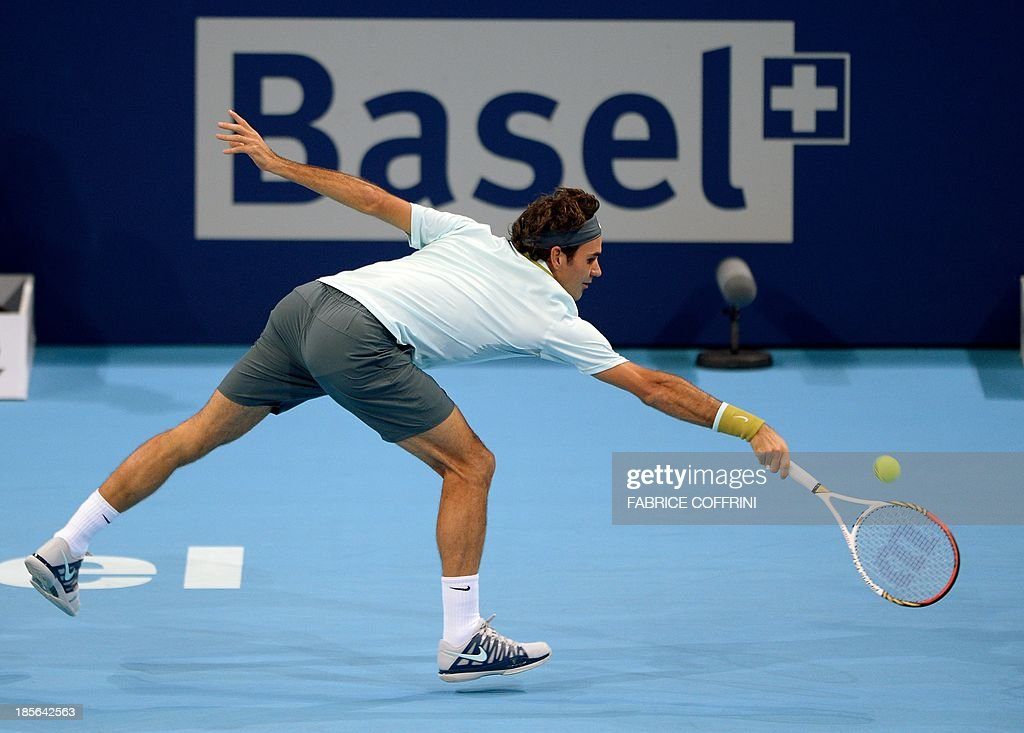 Switzerland's Roger Federer returns a ball during his match against Uzbekistan's Denis Istomin on October 23, 2013 at the Swiss Indoors tennis tournament in Basel. AFP PHOTO / FABRICE COFFRINI