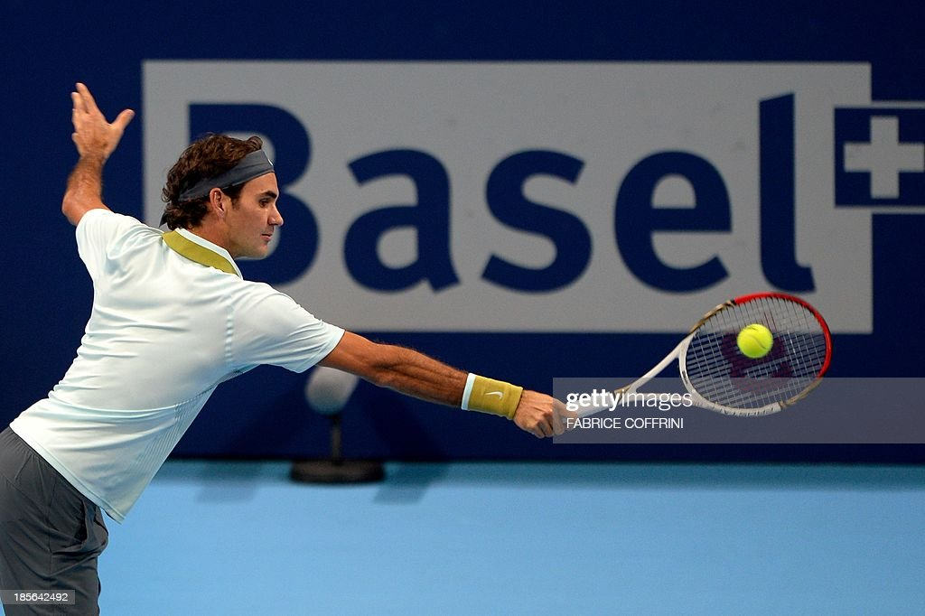 Switzerland's Roger Federer returns a ball to Uzbekistan's Denis Istomin on October 23, 2013 at the Swiss Indoors tennis tournament in Basel.