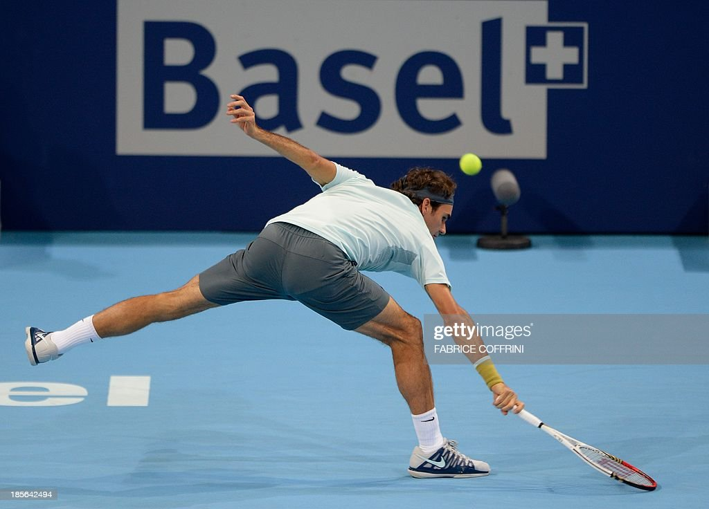 Switzerland's Roger Federer returns a ball to Uzbekistan's Denis Istomin on October 23, 2013 at the Swiss Indoors tennis tournament in Basel. AFP PHOTO / FABRICE COFFRINI
