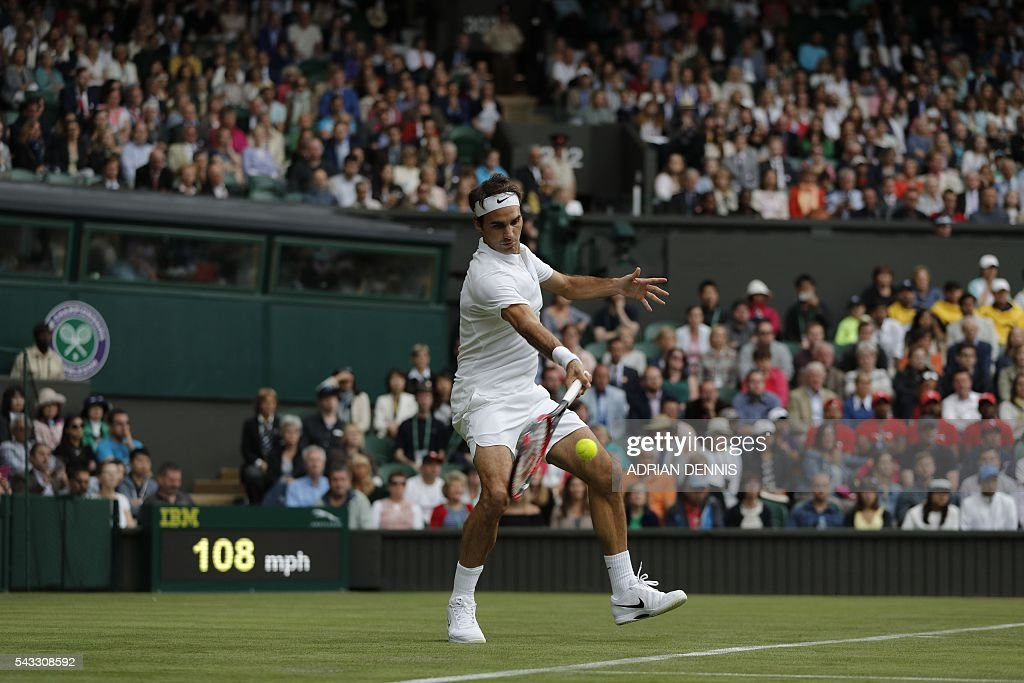 Switzerland's Roger Federer returns against Argentina's Guido Pella during their men's singles first round match on the first day of the 2016 Wimbledon Championships at The All England Lawn Tennis Club in Wimbledon, southwest London, on June 27, 2016. / AFP / ADRIAN