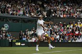Switzerland's Roger Federer returns against Argentina's Guido Pella during their men's singles first round match on the first day of the 2016...