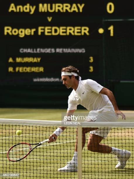 Switzerland's Roger Federer returns against Britain's Andy Murray during their men's semifinal match on day eleven of the 2015 Wimbledon...