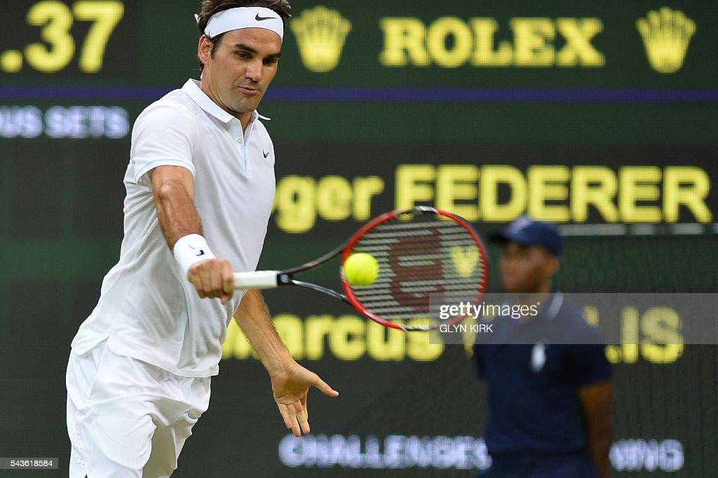 Switzerland's Roger Federer returns against Britain's Marcus Willis in their men's singles second round match on the third day of the 2016 Wimbledon Championships at The All England Lawn Tennis Club in Wimbledon, southwest London, on June 29, 2016. / AFP / GLYN