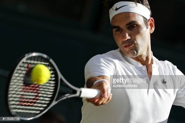 Switzerland's Roger Federer returns against Bulgaria's Grigor Dimitrov during their men's singles fourth round match on the seventh day of the 2017...