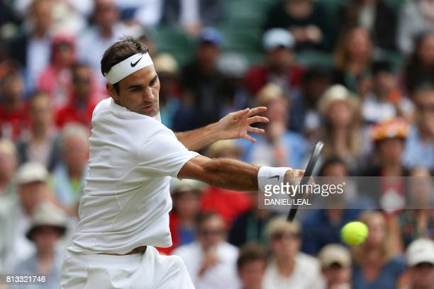 Switzerland's Roger Federer returns against Canada's Milos Raonic during their men's singles quarterfinal match on the ninth day of the 2017...