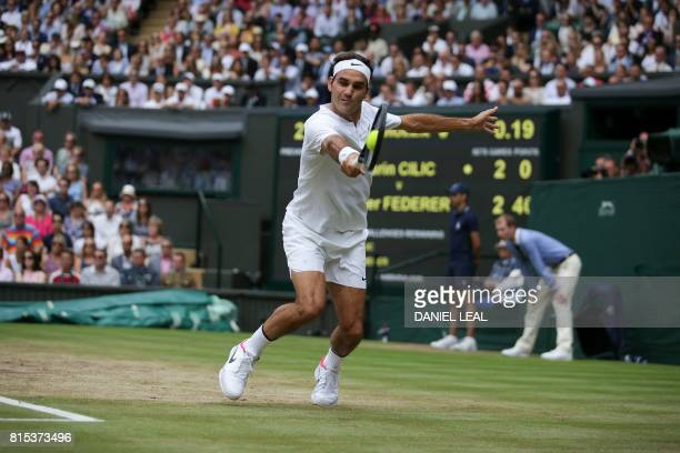 TOPSHOT Switzerland's Roger Federer returns against Croatia's Marin Cilic during their men's singles final match on the last day of the 2017...
