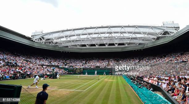 Switzerland's Roger Federer returns against Croatia's Marin Cilic during their men's singles final match on the last day of the 2017 Wimbledon...