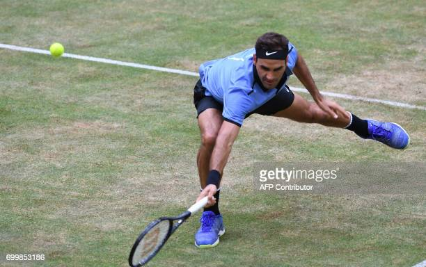 Switzerland's Roger Federer returns the ball to Germany's Mischa Zverev during the ATP tennis tournament in Halle western Germany on June 22 2017 /...