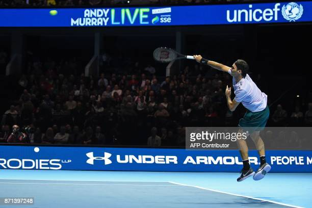 TOPSHOT Switzerland's Roger Federer returns to Britain's Andy Murray in their exhibition tennis singles match during 'Andy Murray Live' at the SSE...