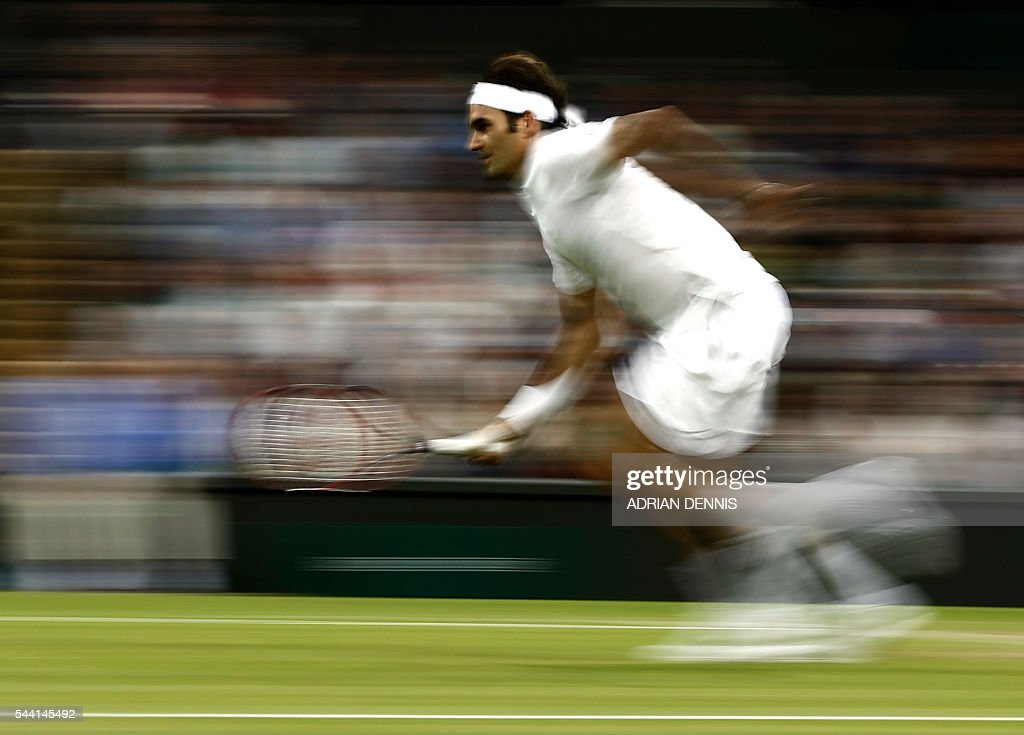 Switzerland's Roger Federer returns to Britain's Daniel Evans during their men's singles third round match on the fifth day of the 2016 Wimbledon Championships at The All England Lawn Tennis Club in Wimbledon, southwest London, on July 1, 2016. / AFP / ADRIAN