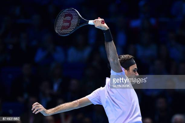 TOPSHOT Switzerland's Roger Federer returns to Croatia's Marin Cilic during their men's singles roundrobin match on day five of the ATP World Tour...