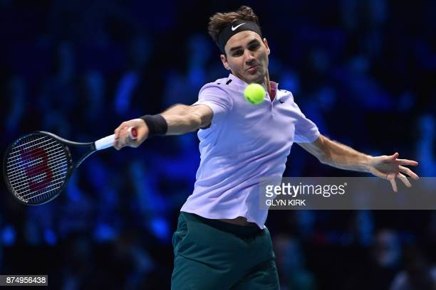 Switzerland's Roger Federer returns to Croatia's Marin Cilic during their men's singles roundrobin match on day five of the ATP World Tour Finals...