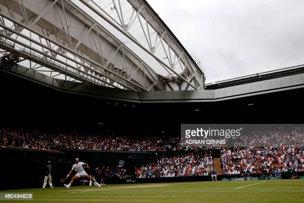 Switzerland's Roger Federer returns to Serbia's Novak Djokovic during their men's singles final match on Centre Court on day thirteen of the 2015...