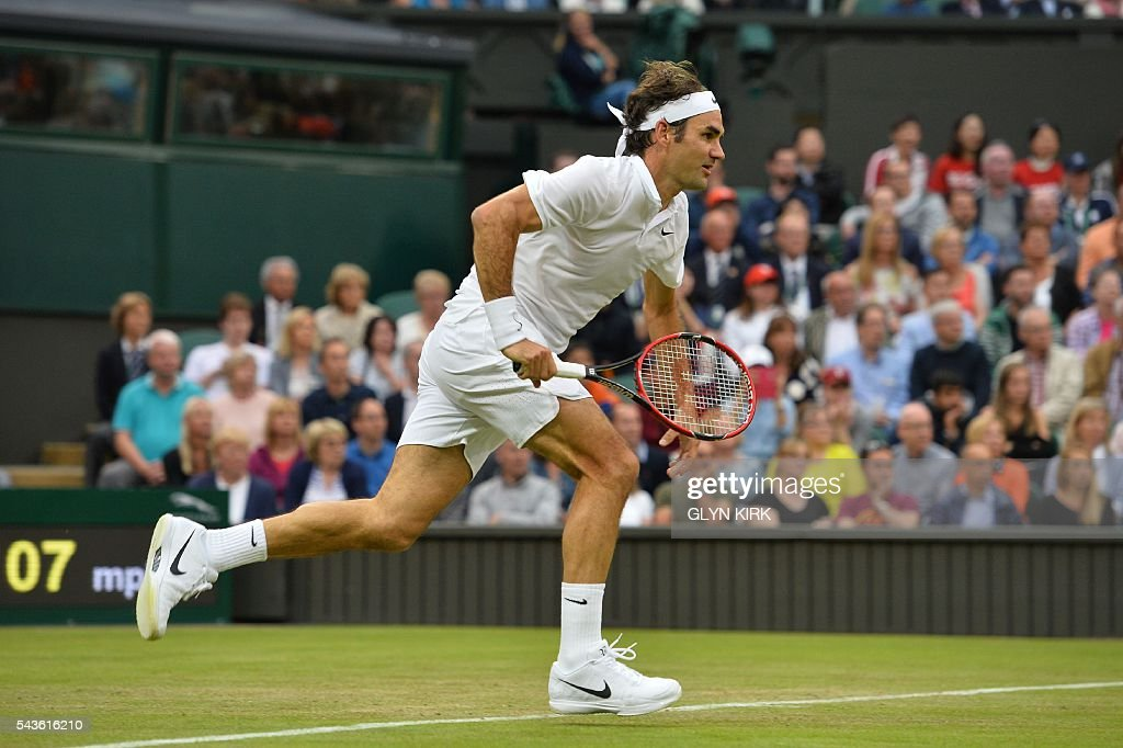 Switzerland's Roger Federer runs for a return against Britain's Marcus Willis in their men's singles second round match on the third day of the 2016 Wimbledon Championships at The All England Lawn Tennis Club in Wimbledon, southwest London, on June 29, 2016. / AFP / GLYN