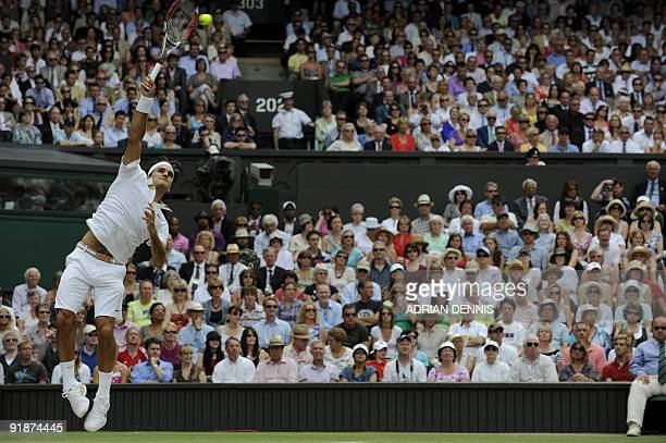 Switzerland's Roger Federer serves a ball to US Andy Roddick during their final match on Day 13 at the 2009 Wimbledon tennis championships at the All...