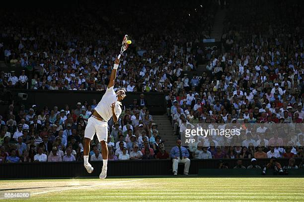 Switzerland's Roger Federer serves a ball to US Andy Roddick in the men's final match on Day 13 at the 2009 Wimbledon tennis championships at the All...