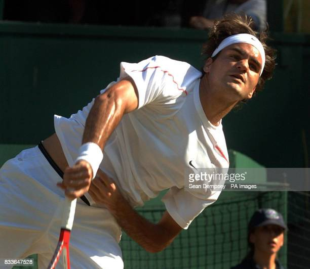 Switzerland's Roger Federer serves against Czech Republic's Tomas Berdych during the fourth round of The All England Lawn Tennis Championships at...
