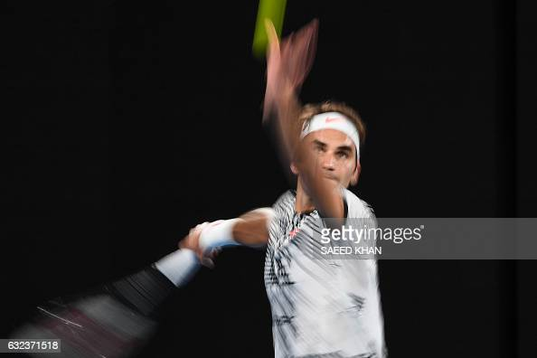TOPSHOT Switzerland's Roger Federer serves against Japan's Kei Nishikori during their men's singles fourth round match on day seven of the Australian...