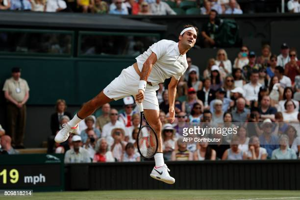 TOPSHOT Switzerland's Roger Federer serves against Serbia's Dusan Lajovic during their men's singles second round match on the fourth day of the 2017...