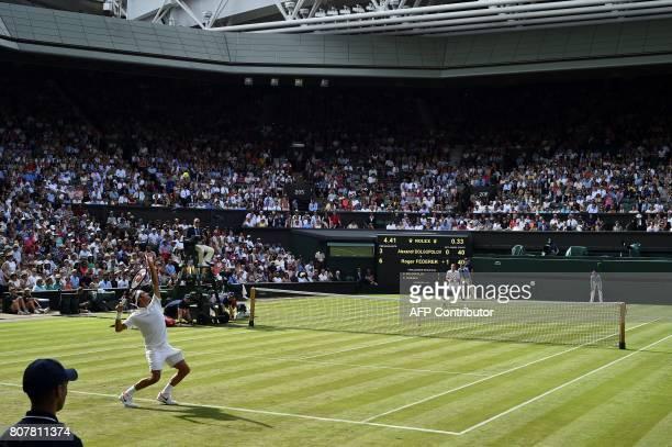 Switzerland's Roger Federer serves against Ukraine's Alexandr Dolgopolov during their men's singles first round match on the second day of the 2017...