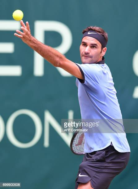 Switzerland's Roger Federer serves the ball to Germany's Mischa Zverev during the ATP tennis tournament in Halle western Germany on June 22 2017 /...