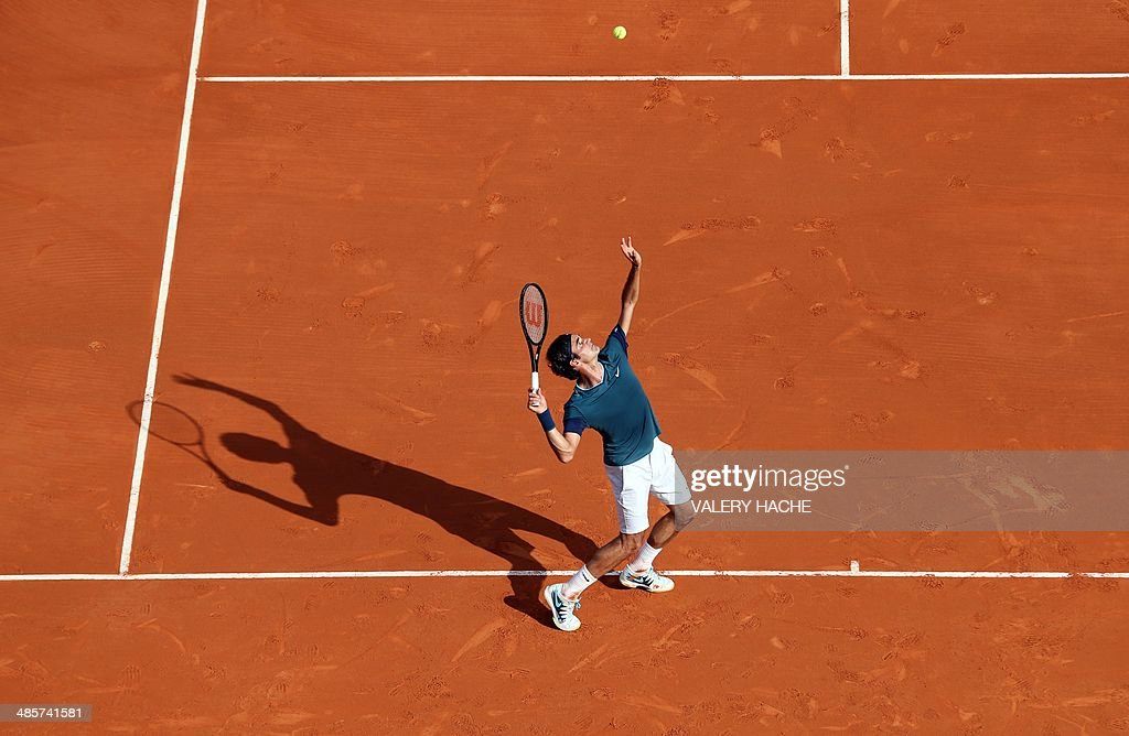 Switzerland's Roger Federer serves to his compatriot Stanislas Wawrinka during their Monte-Carlo ATP Masters Series Tournament tennis match final, on April 20, 2014 in Monaco. AFP PHOTO / VALERY HACHE