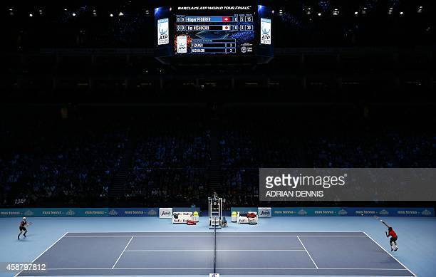 Switzerland's Roger Federer serves to Japan's Kei Nishikori during their Group B singles match on day three of the ATP World Tour Finals tennis...