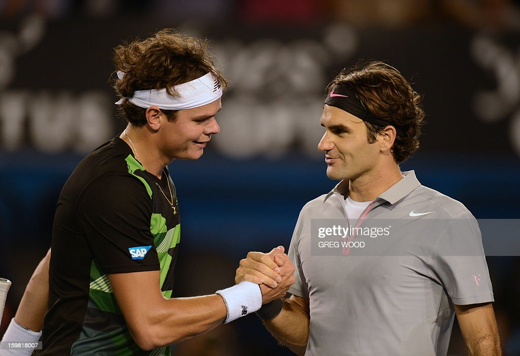 Switzerland's Roger Federer (R) shakes hands after victory in his men's singles match against Canada's Milos Raonic on the eighth day of the Australian Open tennis tournament in Melbourne on January 21, 2013. AFP PHOTO/ GREG WOOD IMAGE STRICTLY RESTRICTED TO EDITORIAL USE - STRICTLY NO COMMERCIAL USE