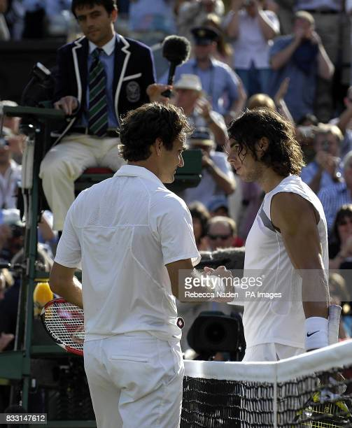 Switzerland's Roger Federer shakes hands Spain's Rafael Nadal after his fifth successive Wimbledon Championship victory in five sets 76 46 76 26 62...