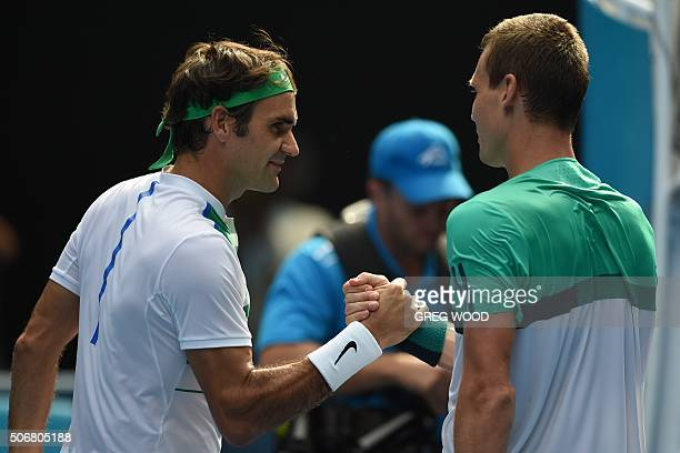 Switzerland's Roger Federer shakes hands with Czech Republic's Tomas Berdych after his victory during his men's singles match on day nine of the 2016...