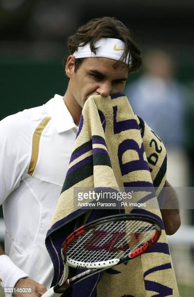 Switzerland's Roger Federer shows his dejection during the Men's Final against Spain's Rafael Nadal during The All England Lawn Tennis Championship...